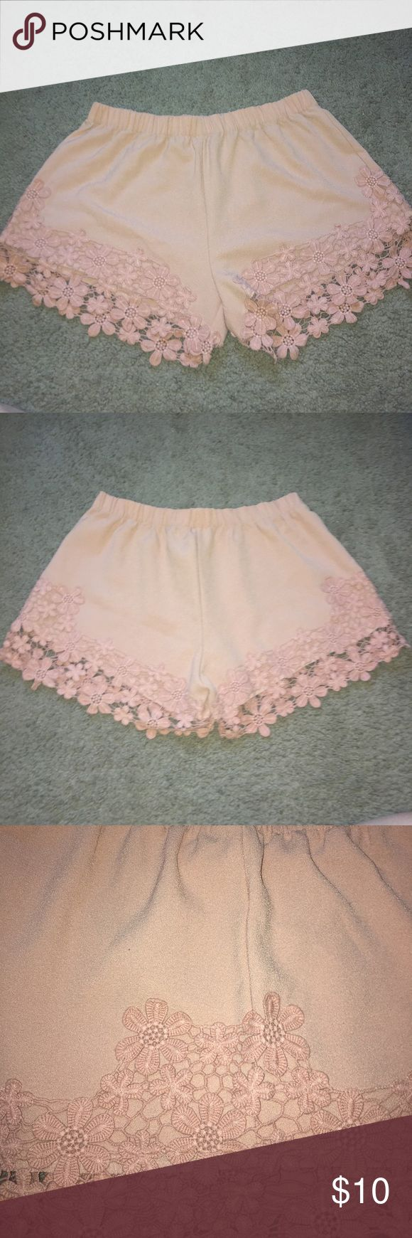 Nude shorts Nude shorts with floral lace on the bottom and side. Slightly worn without tags Shorts