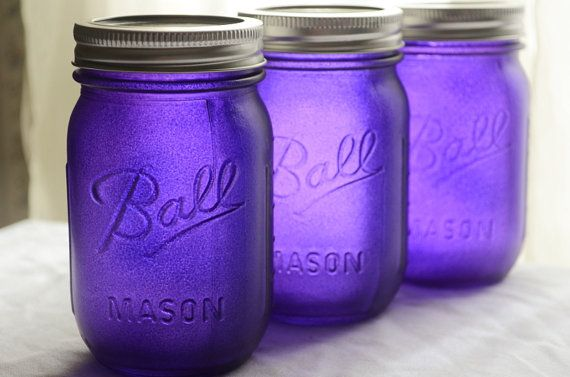 Jars are stained with glass paint on outside. How pretty with a votive inside!