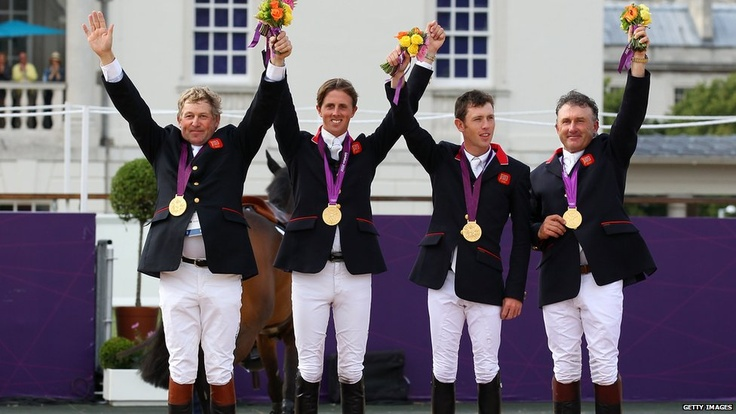 Nick Skelton, Ben Maher, Scott Brash and Peter Charles receiving their gold medals