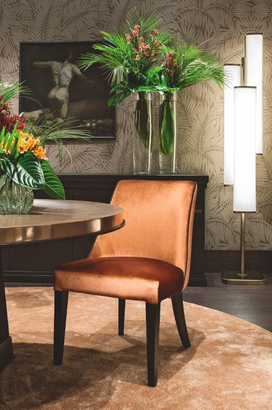 The Musa chair by Oasis, with a velvet orange cover. Perfect for stylish dining rooms.