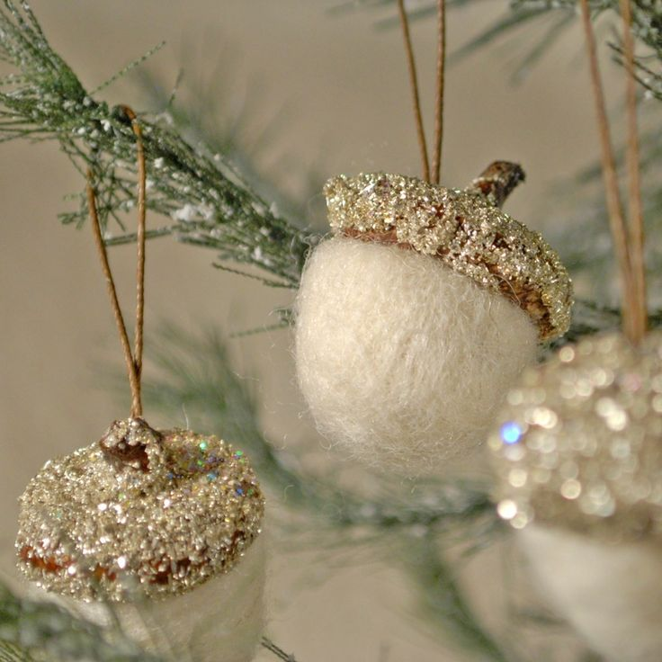Forget buying these~they're a great craft to make! Simply paint the acorns white, top off tops with gold and add glitter. Fun and pretty!