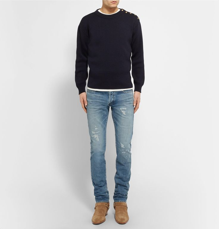 <a href='http://www.mrporter.com/mens/Designers/Saint_Laurent'>Saint Laurent</a>'s denim has come to typify the French label's rebellious spirit. This pure cotton slim-fit pair is cut for a more relaxed take on the brand's signature drainpipe aesthetic, but the distressed and faded patches ensure they're no less rock 'n' roll. Complete the louche Jagger-esque look with a leather jacket.