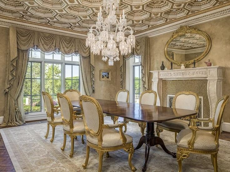 Dining Room with Chandelier, Standard height, Paint 1, Transom window, other fireplace, Glass panel door, Fireplace