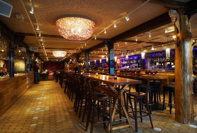 Communal high tops and bar at Beat Hotel-Beehive gets a sister in Cambridge