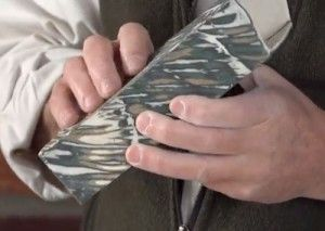 Curt Benzle explains how to create interesting pattern and texture by carving a slab of layered, colored slip.
