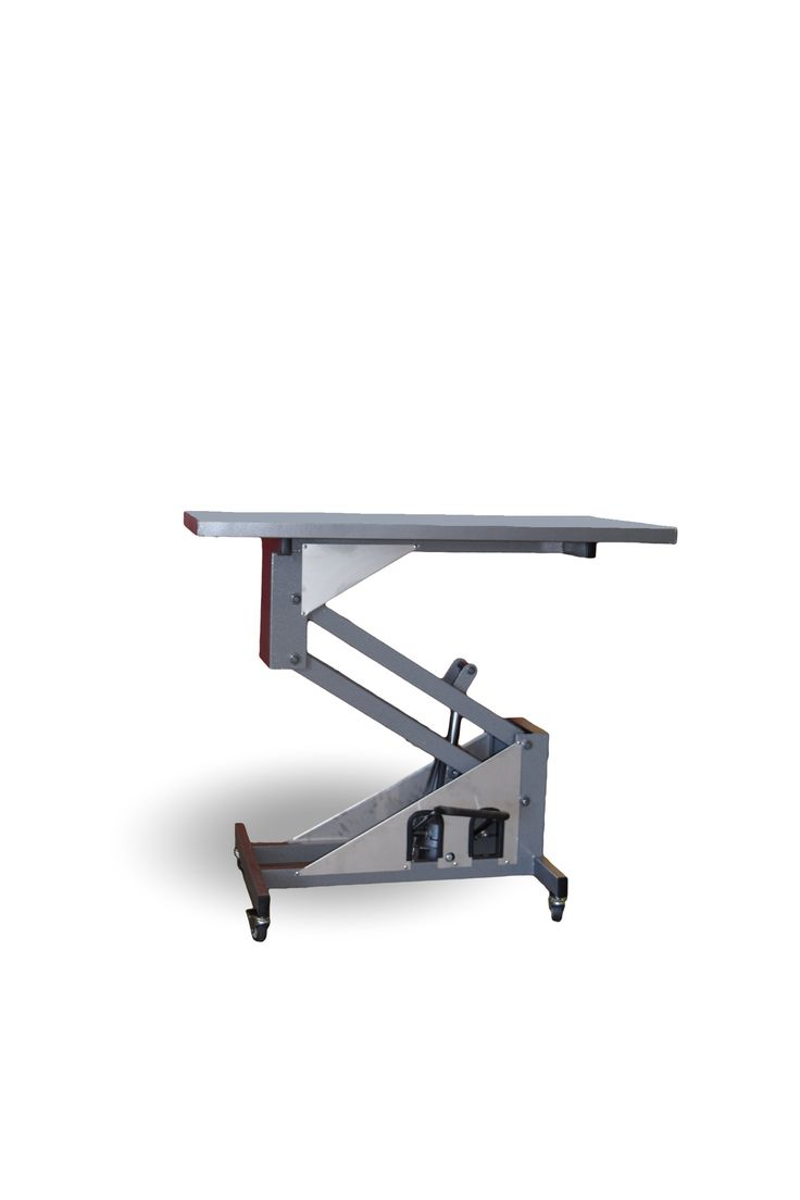 Portable hydraulic work table. Lift and lower table with a foot pump to keep your hands free, portable to take your work with you. welding table/ shop / wearhouse
