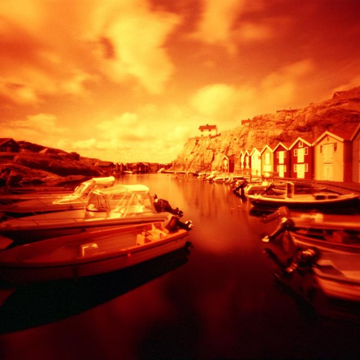 Picture by Ulf Rehnholm shot with a pinhole camera and analog redscale film.