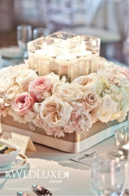 styrofoam base, wrapped in pale gold/champagne, topped with flowers glued on, with small vase filled with flowers (and maybe a e-candle)
