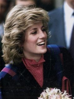 princes diana february 1984. She has a beautiful smile. I want to know how she got her hair so volumenous