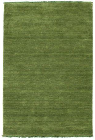 Handloom fringes - Mörkgrön matta 120x180