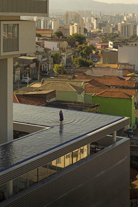 360º Building in São Paulo by Isay Weinfeld with walk around pool.