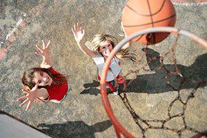 Girls playing basketball.