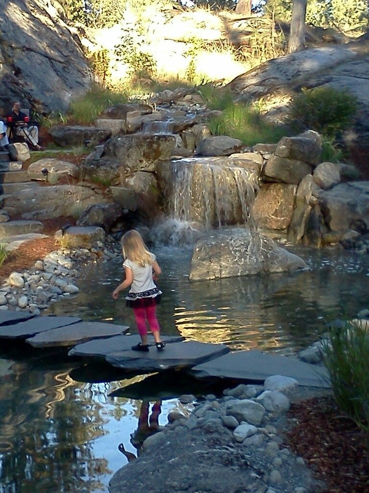 1000 ideas about backyard stream on pinterest backyard for Pictures of ponds with waterfalls
