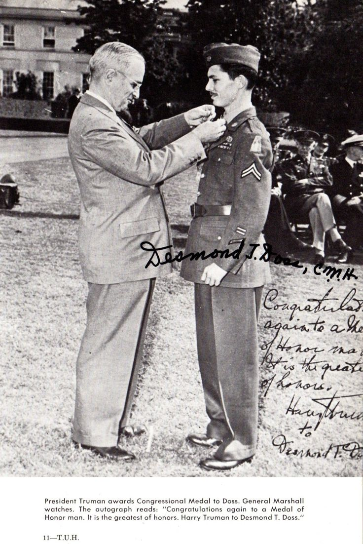 DOSS DESMOND: (1919-2006) United States Army Corporal, Combat Medic in World War II. The only conscientious objector to receive the Congressional Medal of Honor medal during World War II. The subject of film director Mel Gibson's World War II drama, Hacksaw Ridge (2016). The image depicting Doss, in full length pose, receiving the Congressional Medal of Honor from President Truman. Signed ('Desmond J. Doss')