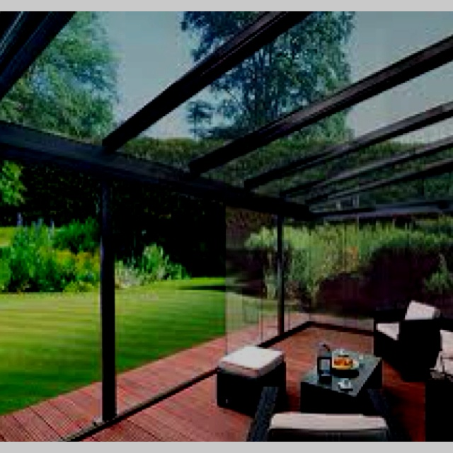 Enclosed outdoor patio with sliding glass walls great for Sliding glass walls for patios
