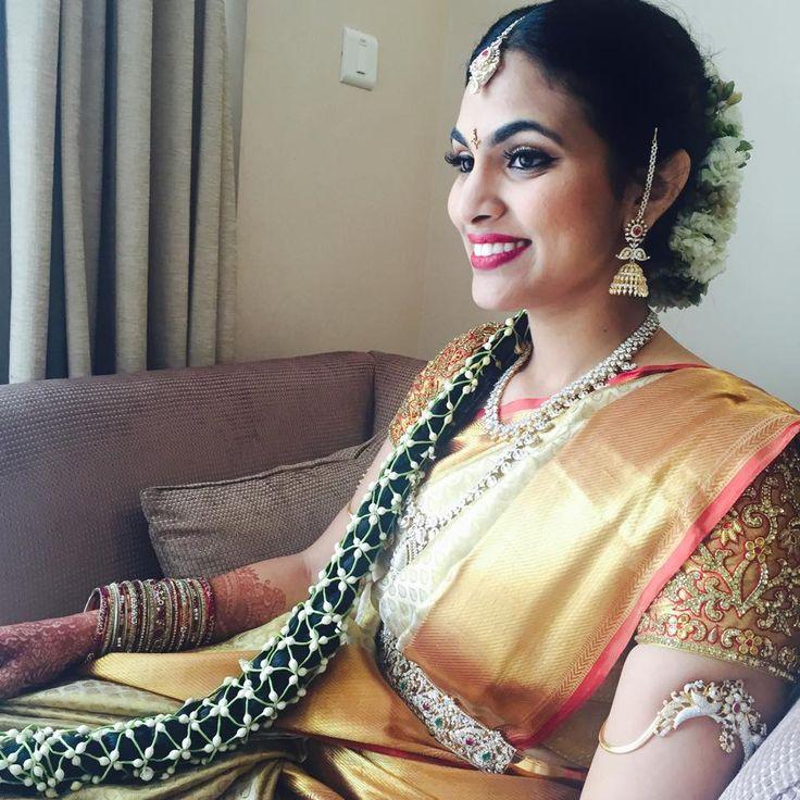 Traditional Southern Indian bride wearing bridal silk saree, jewellery and hairstyle. #IndianBridalMakeup #IndianBridalFashion #HairAccessory Temple jewelry. Jhumkis. Silk kanchipuram sari. Braid with fresh flowers. Tamil bride. Telugu bride. Kannada bride. Hindu bride. Malayalee bride