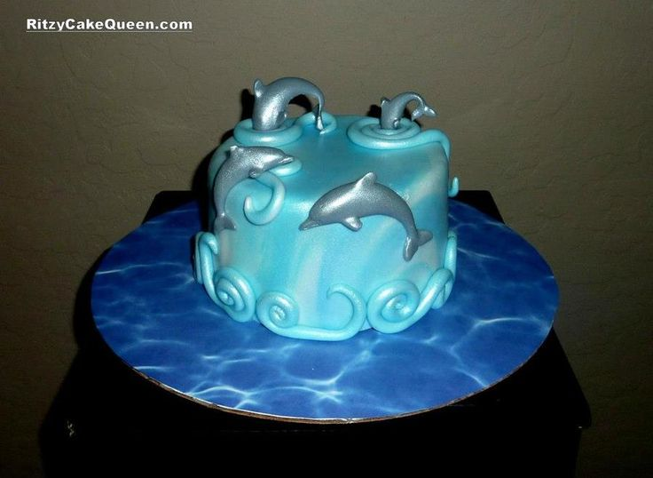 """Dolphins Diving into Cake"""