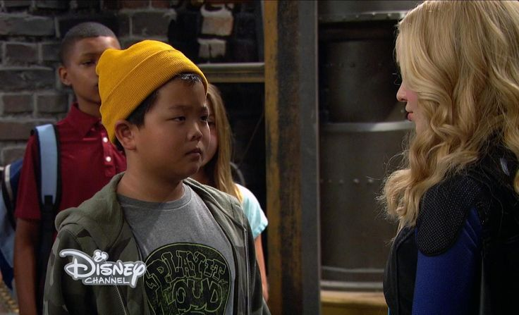 """Looks like Liv has got some explaining to do! On the upcoming Liv and Maddie episode """"Coach-A-Rooney,"""" Liv (Dove Cameron) is hosting a fan meet-and-greet for her superhero-themed TV show Voltage, but one superfan has a lot questions. Like 38 of them. In this exclusive sneak peek at the episode, guest"""
