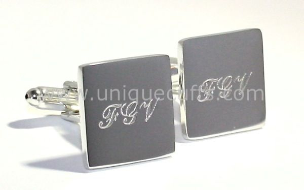 Sterling silver cufflinks plated with 18k white gold, and engraved with the initials of your groomsmen.