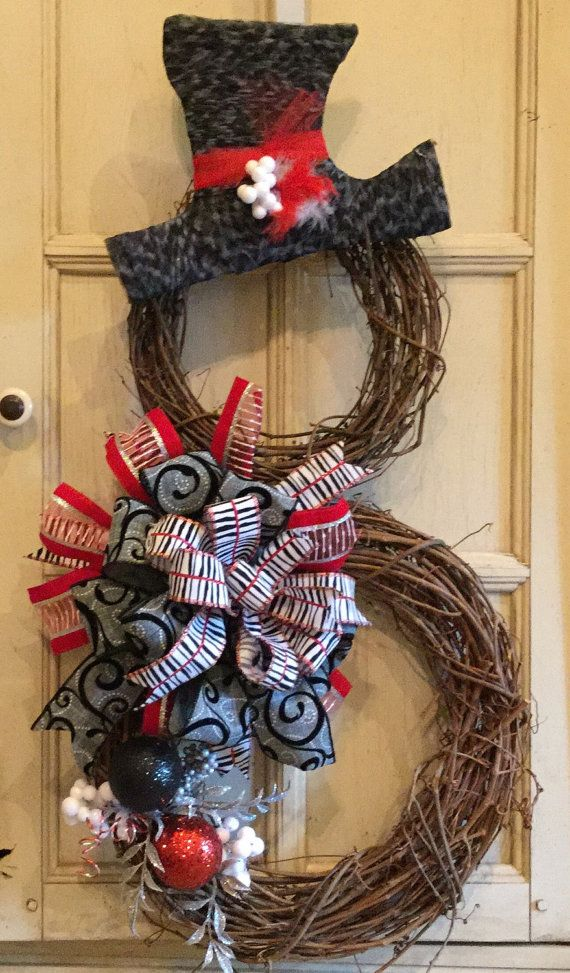 Totally awesome snowman grapevine wreath for winter and Christmas. Made with black, white, and red, fun and funky holiday wreath. Two sizes of