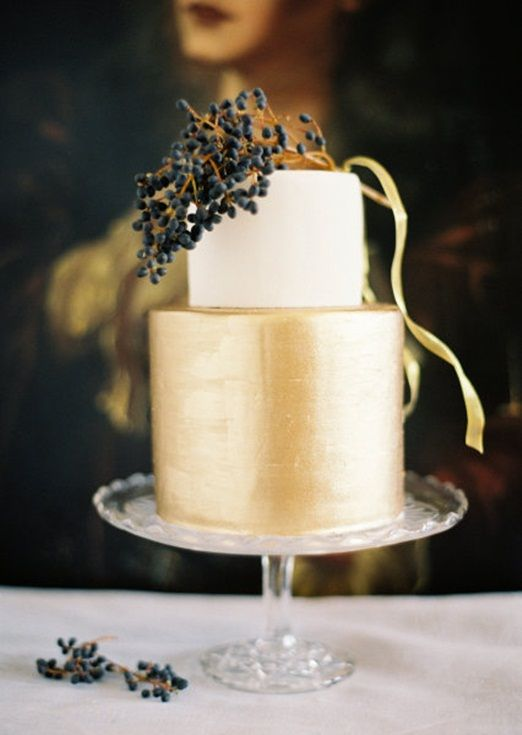 Elegant gold wedding cake with black berries -  Photo by Jose Villa via Style Me Pretty
