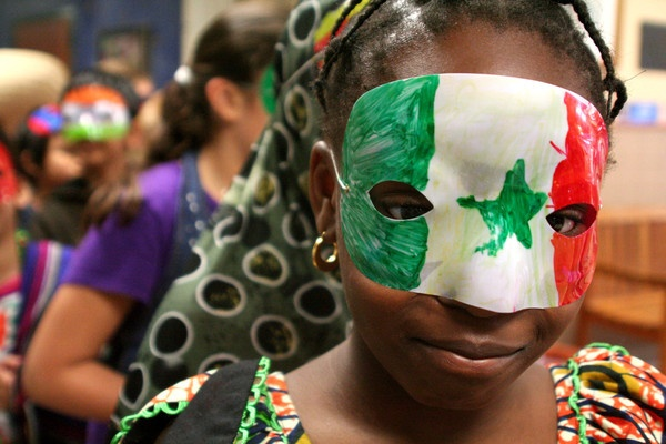 A student parades through the Alice Smith hallways during the school's cultural festival.: Student Parades, Hopkins Schools, Photo