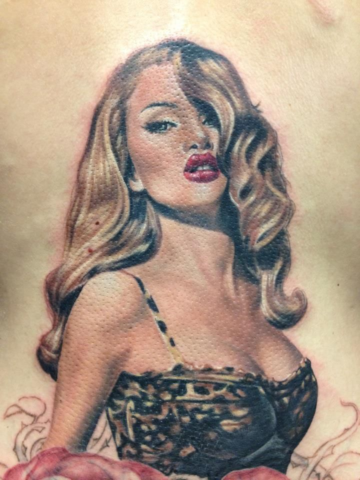 Beautiful realistic! Hair & Makeup ON POINT!   Leopard Print Pin Up Tattoo On Back