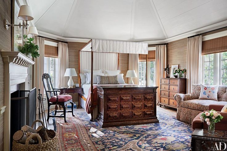 Talent agent Kevin Huvane called on designer Michael S. Smith to renovate his mansion in Los Angeles. A pop-up television unit by David Iatesta stands at the foot of a Queen Anne–style bed in a guest room; the table lamps are from Christopher Spitzmiller, the circa-1900 chest of drawers is from Lee Stanton Antiques, and the circa-1750 lacquer armchair is from Hollyhock.