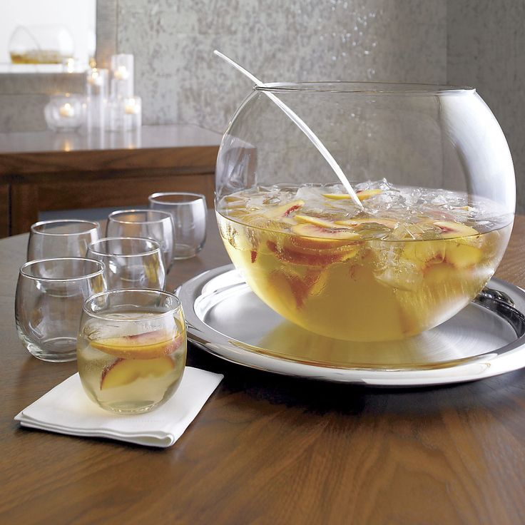 Shop Glass Punch Bowl Set.  Put some punch in your party with our complete set for eight.  Fishbowl-style bowl coordinates with modern, handle-free cups and a sweeping scooped ladle.