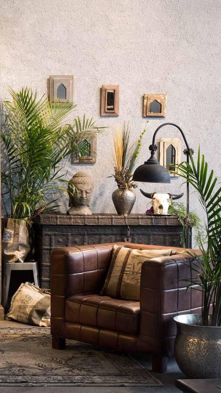Antique Indian living area with a modern leather seat as a center piece.