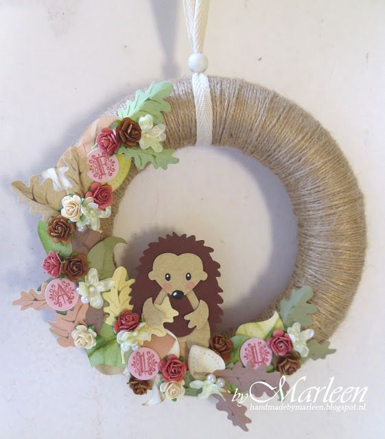 Wreath made by DT member Marleen with Creatables Acorn with Leaf (LR0373), Craftables Circle & Flower Stitch (CR1248), Collectables Flower Set (COL1316), Hedgehog (COL1368) and Vintage Alphabet (COL1380) by Marianne Design