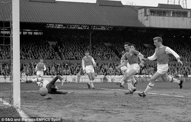 Bobby Tambling (centre) bearing down on goal as Chelsea score past Arsenal keeper Jack Kelsey