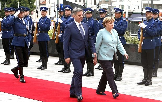 German Chancellor Angela Merkel in Sarajevo<br>epa04838265 German Chancellor Angela Merkel (C-R) and Bosnian Prime Minister Denis Zvizdic (C-L) inspect a guard of honor during a welcoming ceremony in Sarajevo, Bosnia and Herzegovina, 08 July 2015. Merkel is on a one-day visit in Bosnia while touring the Balkan countries which are looking to become European Union members in the future.