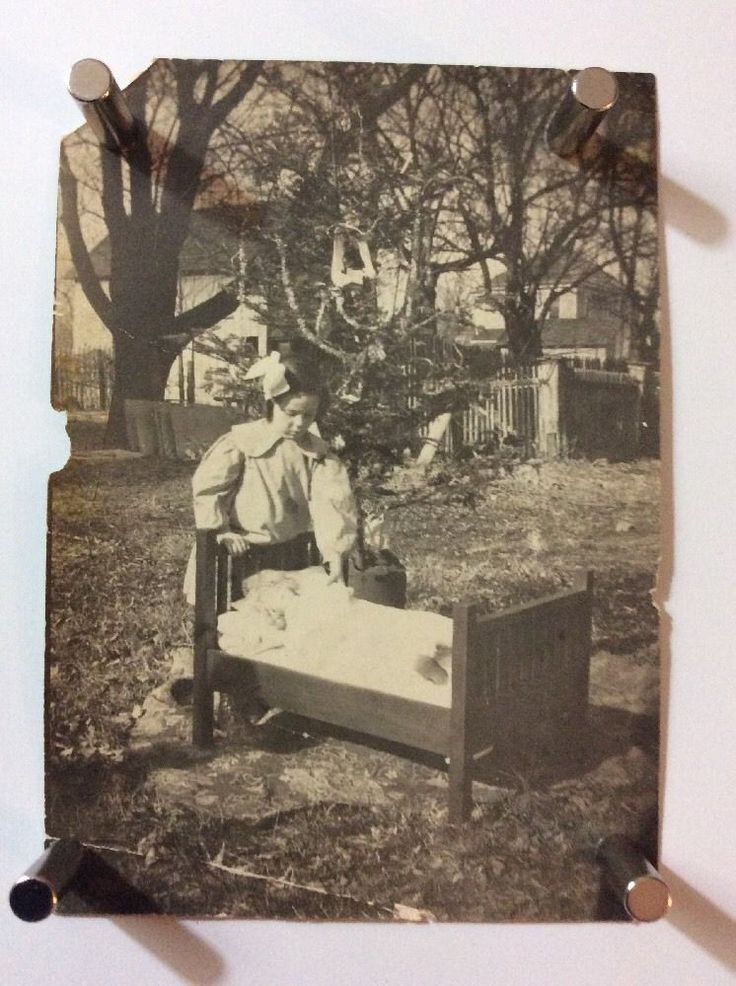 Vintage Oddity Photograph Of Girl Outside With Crib, Doll And Christmas Tree