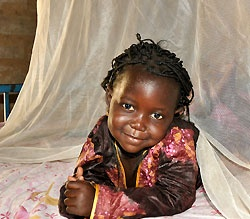 Little girl with a malaria bed net in Senegal.