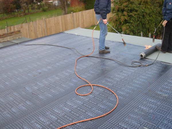 Flat Roofs Are Generally Shrouded In Bituminous Based Black Top Or Material  Felt,
