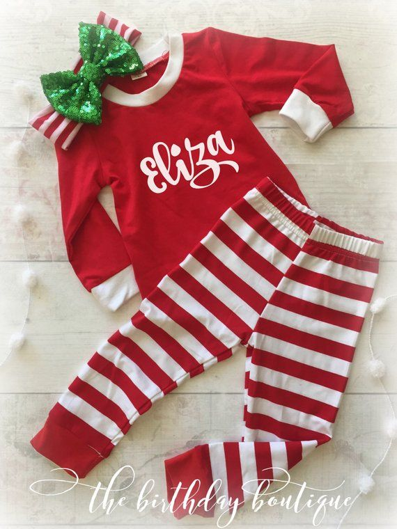 35a45eb2e2 TWO PIECE PAJAMA SET  95% cotton and 5% Polyester Shirt in red with white  neckline and cuffs. Pants are red and white striped with red cuffs on the  bottom.