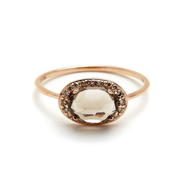 This romantic version of the Pavé Amulet Ring features a hazy 8x6mm smoky quartz gemstone set inverted in rich rose gold with a dazzling frame of champagne diam