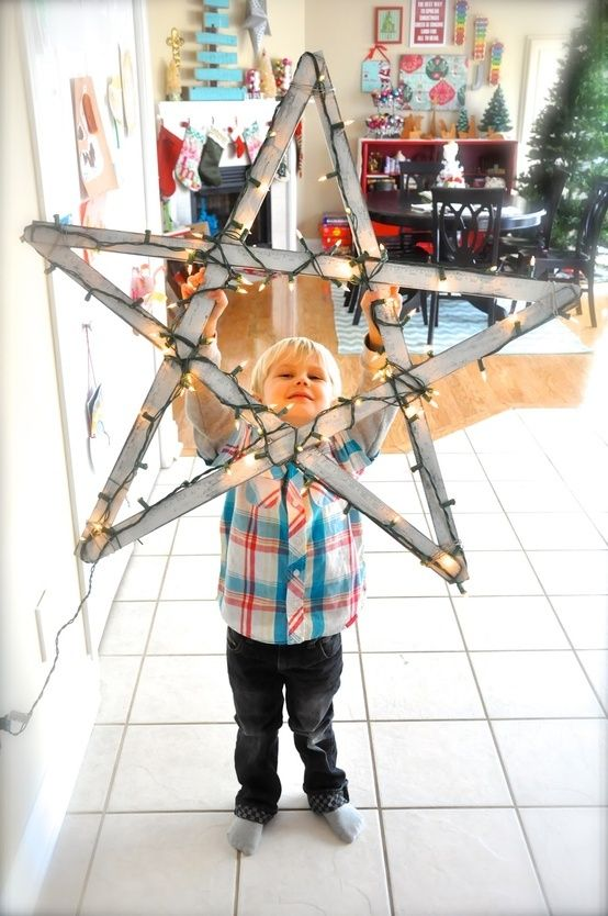 5 yardsticks   string lights = bright holiday star.- doing this for front porch :)