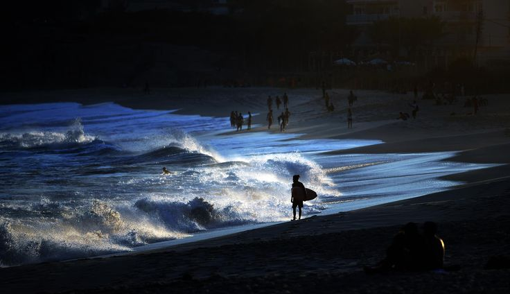by Jewel Samad - AFP A surfer walks along the shore at a beach in Barra, west of Rio de Janeiro on August 1, 2016 ahead of the Rio 2016 Olympic Games.