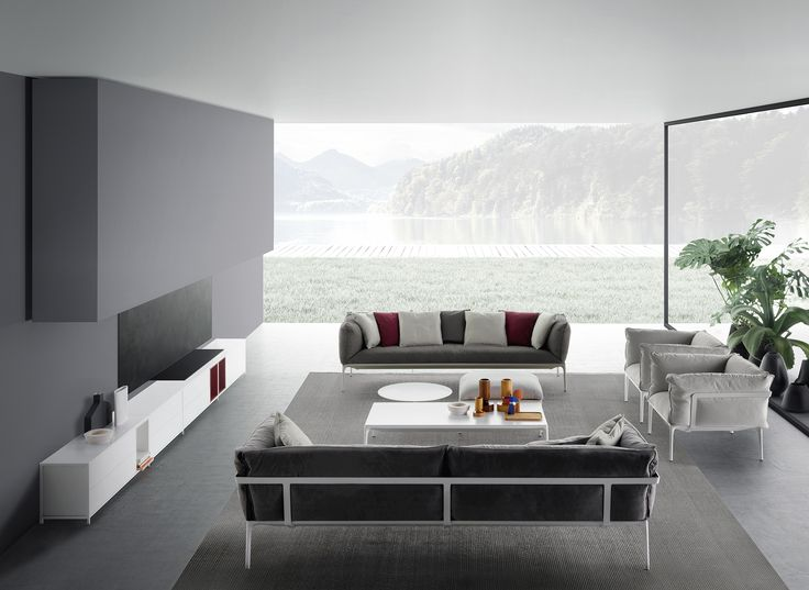 Elegant and timeless living room with Mdf Italia products with a lake in the background. Protagonist of the space is the Yale sofas and armchair designed by Jean Marie Massaud.