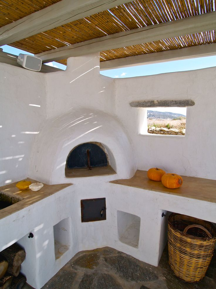 Traditional oven, concrete counters, local decoration. Paros, Greece
