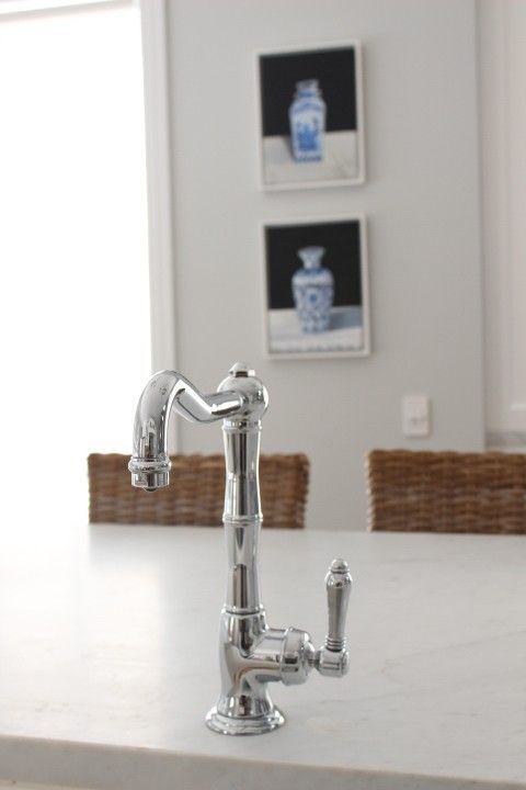 Marble and white Kitchen , chrome mixer tap, marble bench top, custom artwork, wicker stools, Melinda Hartwright Interiors