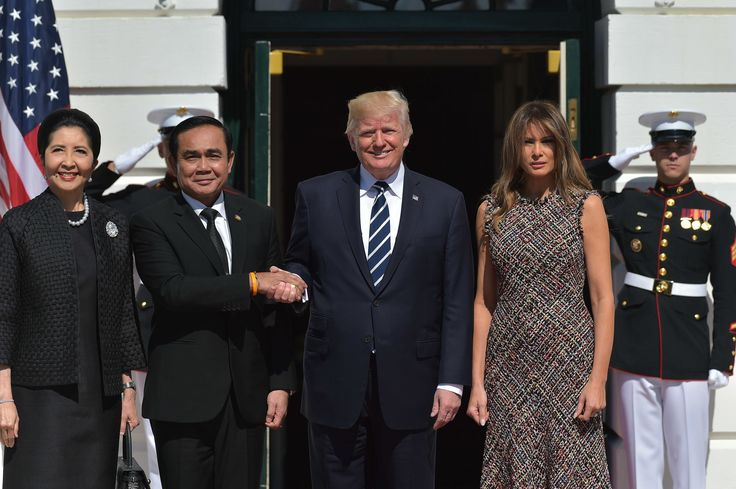 US President Donald Trump and First Lady Melania Trump greets Thailand's Prime Minister Prayut Chan-o-cha and wife Naraporn Chan-ocha upon arrival at the South Portico of the White House on October 2, 2017