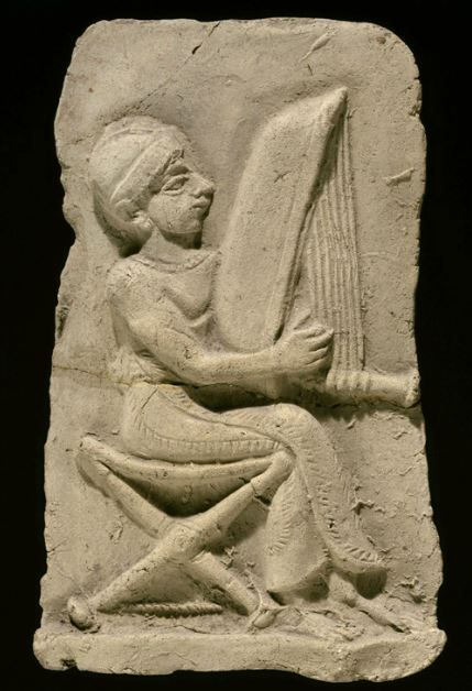 Isin Larsa plaque with a harpist, 8.4 cm high. Louvre Museum