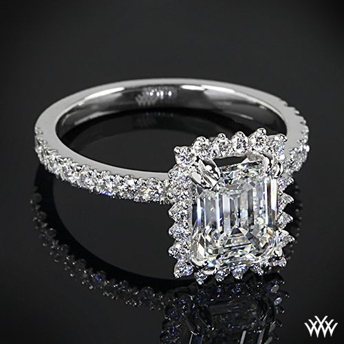 This Custom Diamond Engagement Ring is set in platinum and holds 0.50ctw A CUT ABOVE® Hearts and Arrows Diamond Melee along the shank and emerald shaped halo. The 4 prongs hold a gorgeous 2.07ct emerald cut diamond.