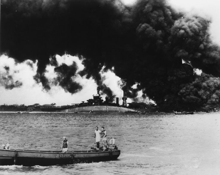Burning ships in the harbor. (Photo: Newscom)