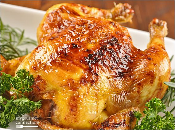 An excellent choice for a dinner party, these roasted Cornish game hens are flavored with a sweet-smoky glaze made with bourbon and honey.