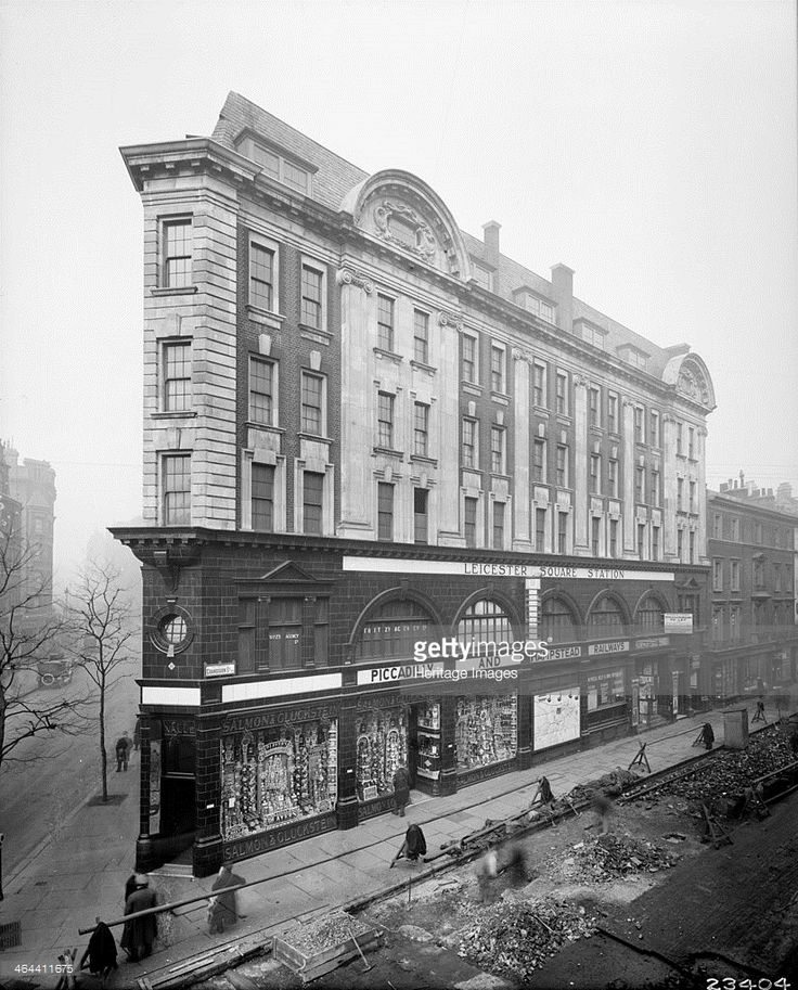Entrance to Leicester Square Tube Station in Cranbourn Street, London, 1916. An interchange for the Piccadilly and Northern Lines [then the Hampstead Line], the building is faced in tiles. The corner houses the premises of Salmon & Gluckstein.