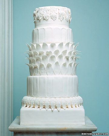 Corinthian Cake – Love the layered leaves in the middle, not so much the overall column look